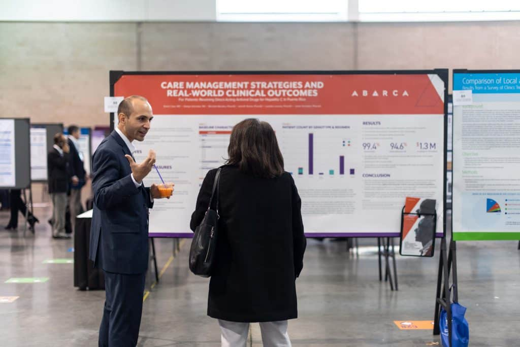 David Capo presents his poster at the AMCP Annual Conference, detailing a care management plan Abarca implemented to help patients with Hepatitis C.