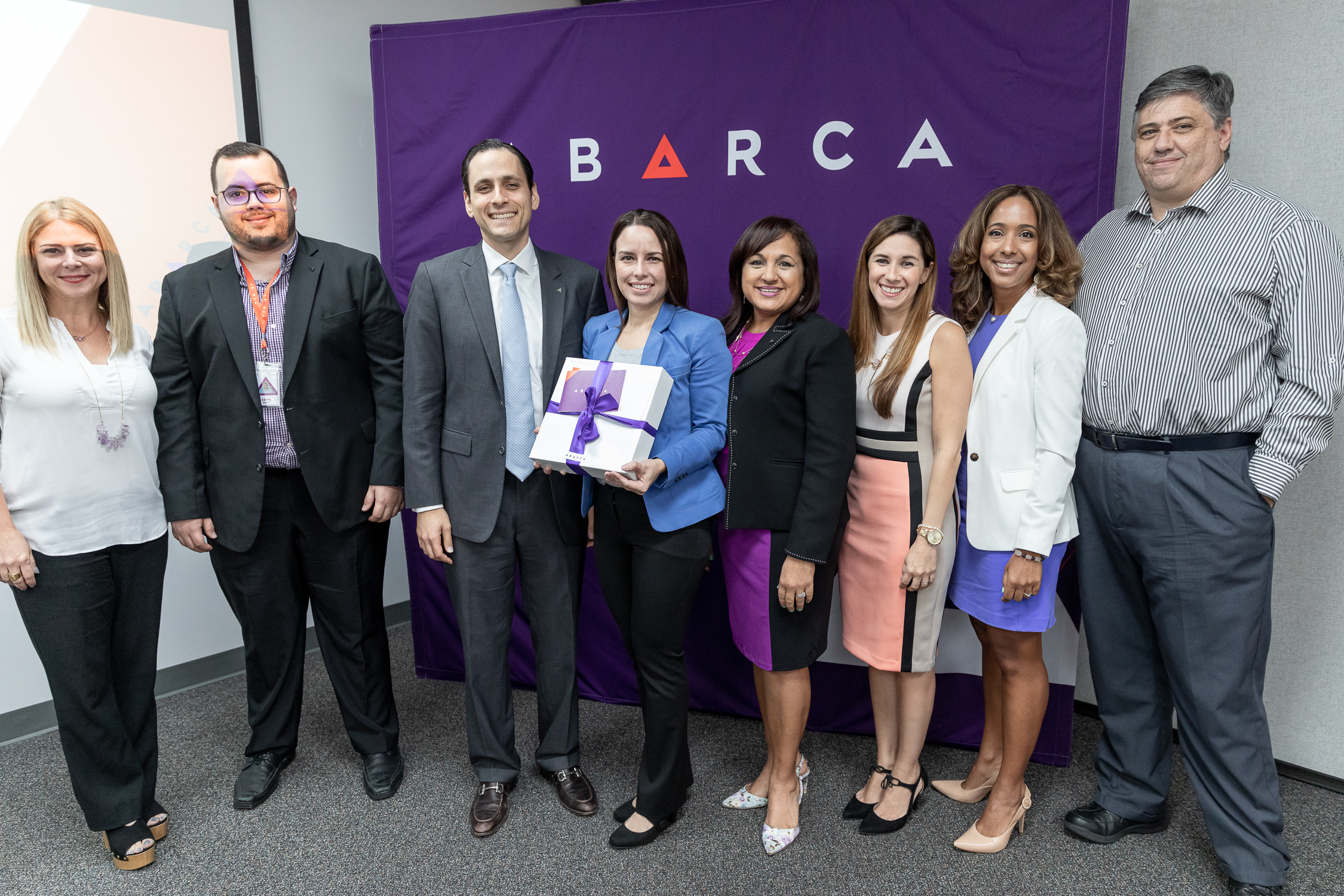 Abarca's President & CEO, Jason Borschow, Nayda Rivera, (President of the #BetterCare Community Committee), stand proudly alongside Dr. Greetchen Díaz-Munoz (Director of Ciencia PR), as well as the Abarcan volunteer team.